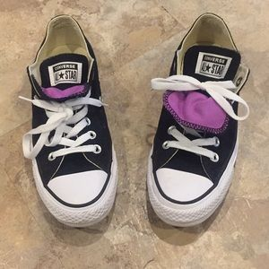 Black converse sneakers with purple tongue